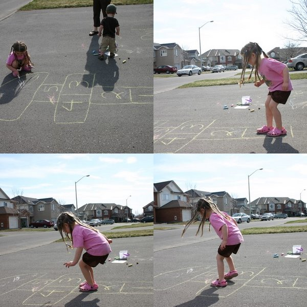 Playing hopscotch in the driveway