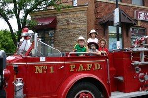 Stephen, Sarah, Ben and Reid on the Bytown Fire Brigade Truck - Frontline Financial raises money for the Canadian Firefighters Monument