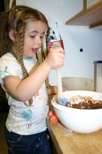 Baking the cupcakes that we contributed to the potluck