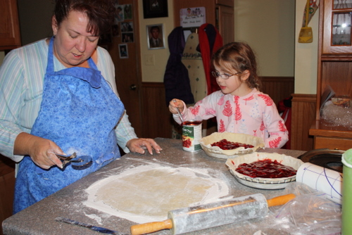 Aunt Karin and Reid making cherry pies