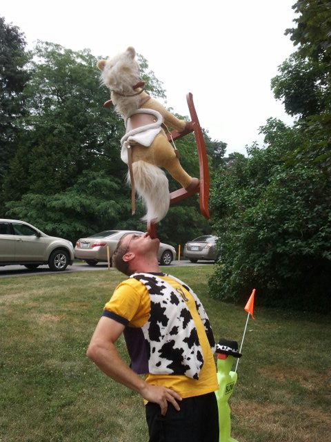 Cow Guy with a rocking horse in mouth